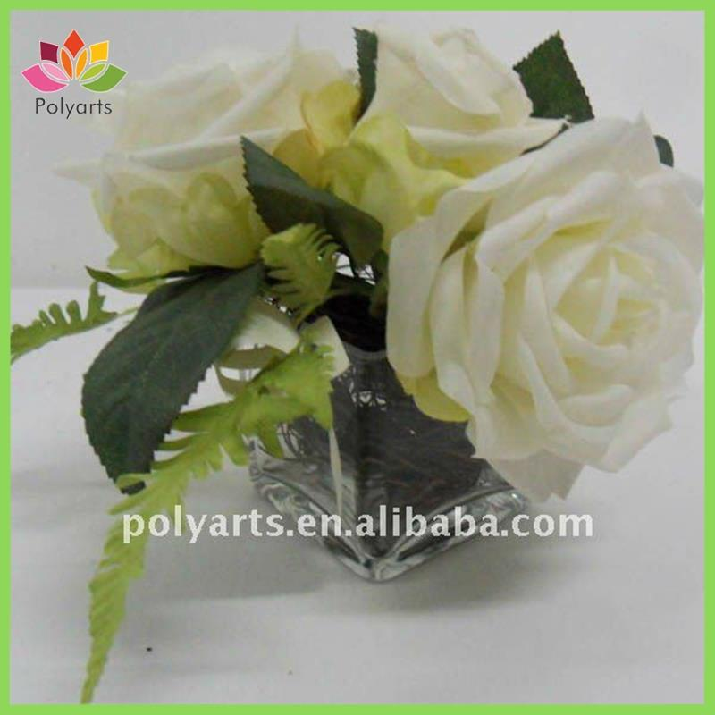 artificial flower roses with glass pot