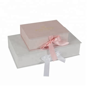 pink hard cardboard packaging with ribbon closure paper gift box