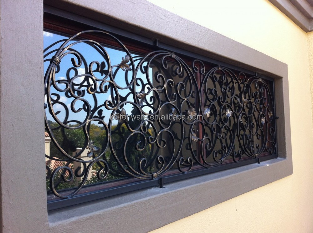 Decorative wrought iron window grills design for sliding for Metal window designs