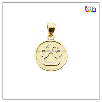 Gold paw print stamp charm with jump ring