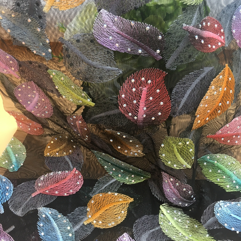 design with leaves in multicolor tulle embroidery fabric with hot rhinestones