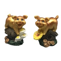gold resin pig stands on the flower design for russia new year decor