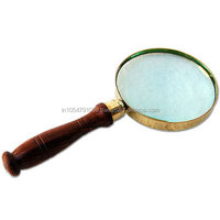 Nautical and brass wooden magnifying glass