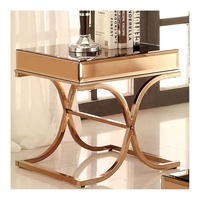 Modern gold mirrored end table with metal frame and curving crossed stainless leg design