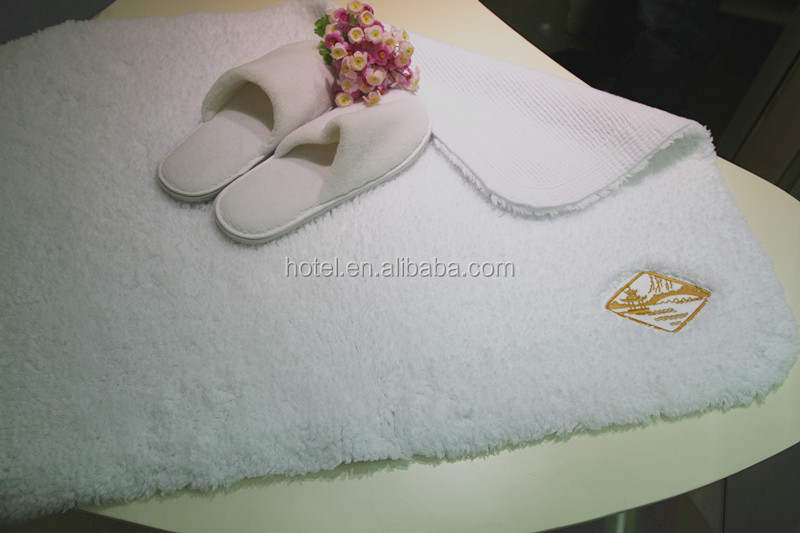 cotton bath rug hand tuffted with embroidered logo