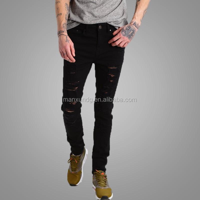 69de8b5274 2017 Top moda negro pantalones hombres pantalones vaqueros del agujero roto  Denim Pantalones para Niño Pantalones