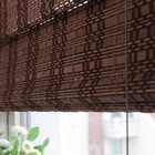 Bamboo slat roller and roman shades blind