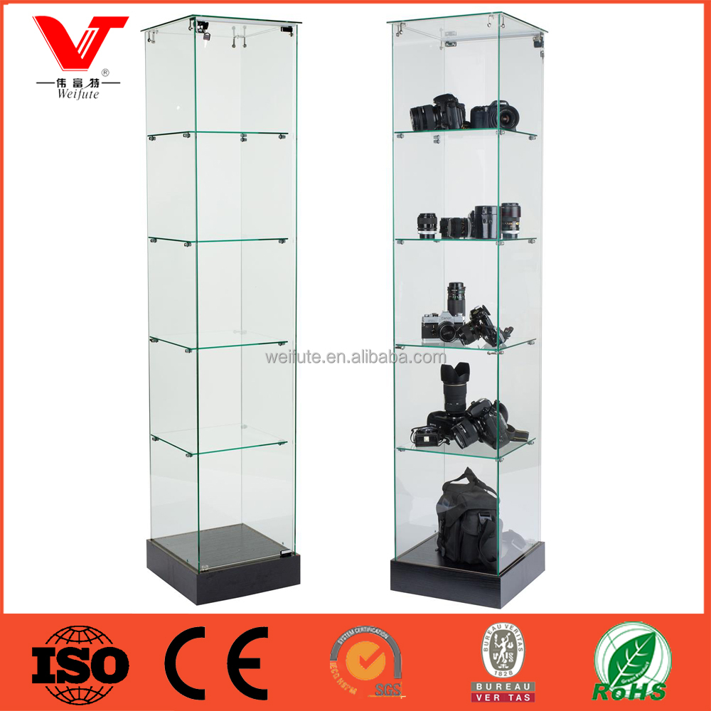 Glass tower display case with hinged door for digital camera store design