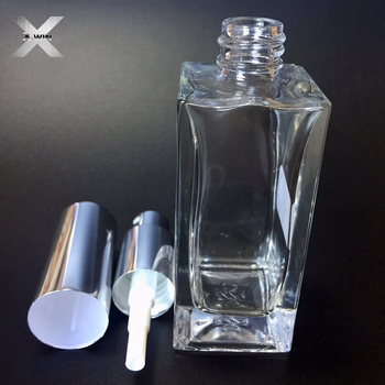 low price 50ml silver lid clear color square shape glass fancy tube perfume bottle