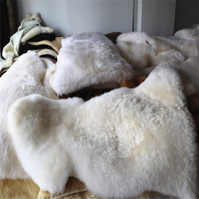 High quality China manufacturer white real fur skin rug wholesale