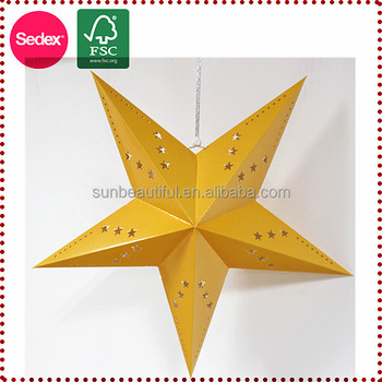 paper xmas star yellow surface on wall for independence day
