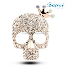 gold plated large crystal skull brooch