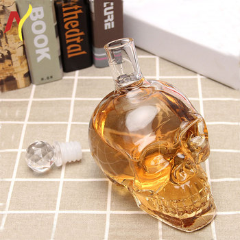 factory made high quality cheap clear skull head shape glass whisky bottles with plastic stopper
