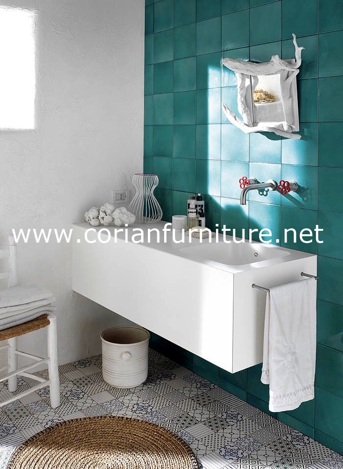 white bathroom vanity with solid surface countertop and built in sink