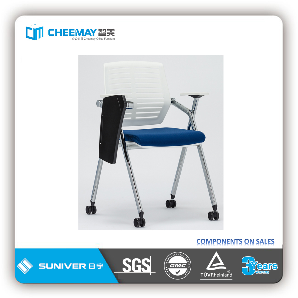 white plastic back student chair with table arm
