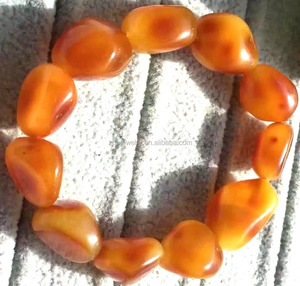 Red color surface Amber nuggets beads bracelets jewellery