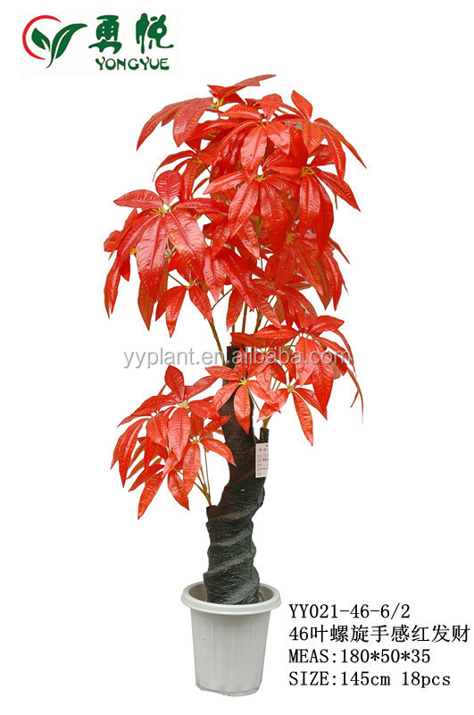 red artificial small bonsai plants. plastic indoor plants. fake