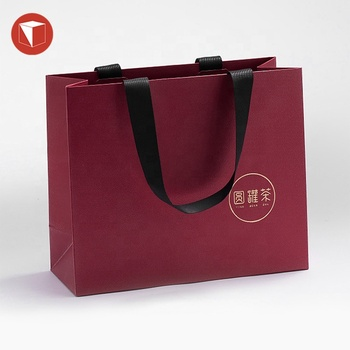 Custom logo gift bag packing gold foil hot stamping paper bag for tea, China flat bottom stand up kraft paper bag with handle