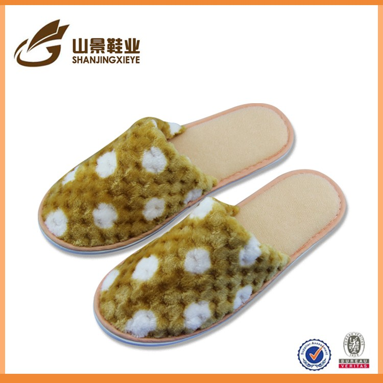Large supply of low-cost household terry cloth indoor slippers