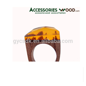 fashionable wood ring made of natural wood and amber
