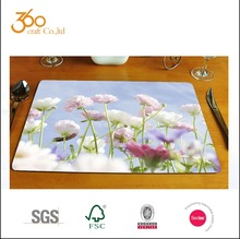 Sublimation blank cork backed placemats with paper on it