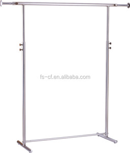 Dress shop's chrome metal free standing hanging clothes display rack with wheels