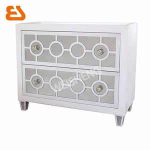 2 drawer white wooden and mirrored cabinet with circle cutting pattern & mirror on drawers