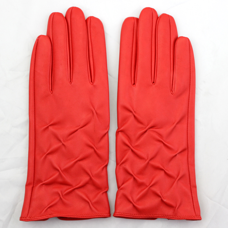 red leather hand gloves winter gloves girls putting on fashion gloves