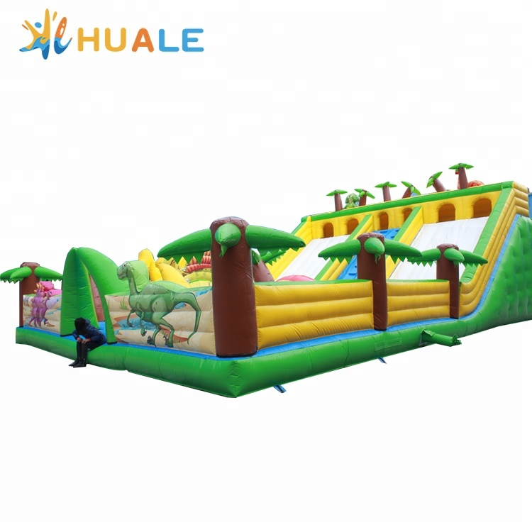 China manufacturer dinosaurs world inflatable bouncy castle slide