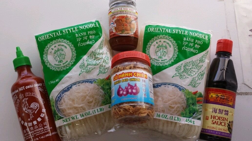 PHO KIT Por Kwan pho broth, rice noodles, hoisin sauce, sriracha and fried onions