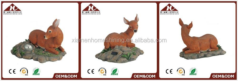 resin deer statue with solar garden lighting