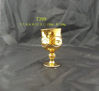 Classic elegant gold plated wine glass with beautiful cutting