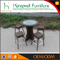 PE rattan high glass round dining table rattan high chairs for restaurant