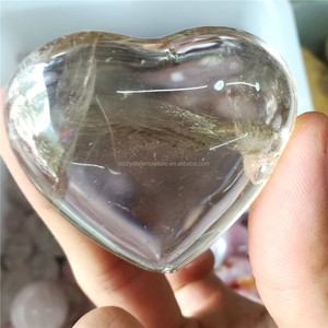 Natural rock hand caved clear quartz crystal heart for sale
