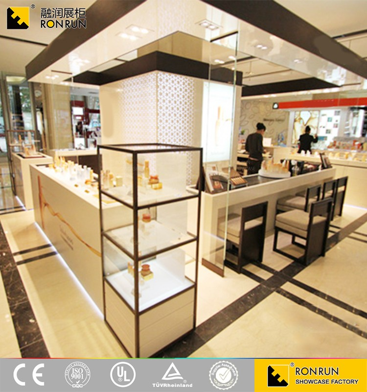Modern and elegant shopping mall white baking paint ultra tempered glass cosmetic kiosk for sales