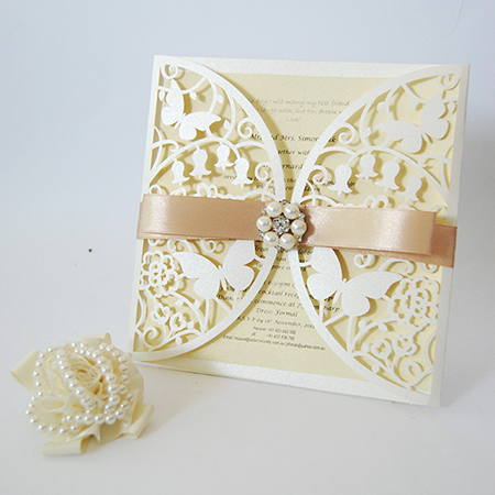 Elegant ivory laser cut wedding invitation card