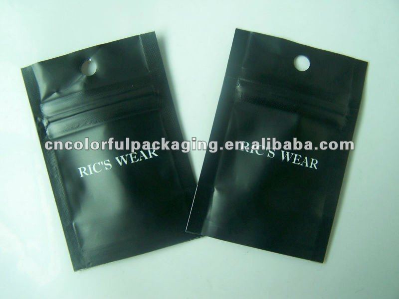Black foil ziplock bags with a perforation for necklace