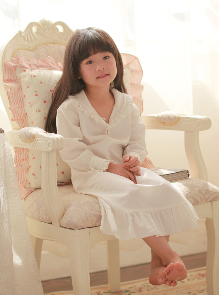 A traditional girls cotton nightdress from Powell Craft - % Cotton. Charlotte Long Sleeved White Cotton Nightie. This nightie has a V shaped neckline, with 3 hidden buttons.