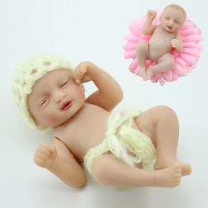 Wholesale cute silicone vinyl baby tiny 4 inch mini reborn palm hand doll for sale sleeping