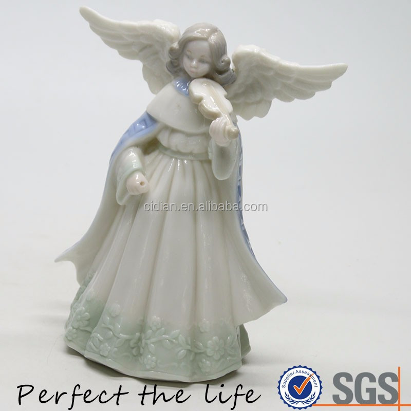 playing violin angel statue with wing
