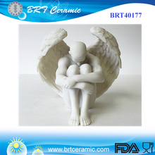 Nude Male Holding Knees Resin Angel Wings Statue