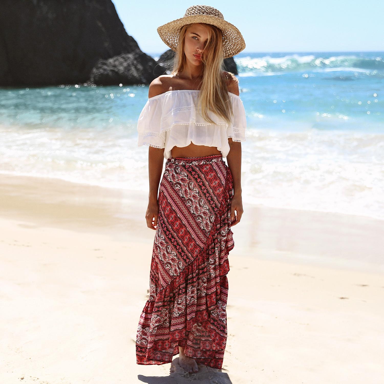 6da7bbb14 Faldas maxi largas Bohemias de estilo caliente de 2019 con estampado de  faldas cortas boho elegantes con pliegues estilo de playa Falda larga maxi  ...