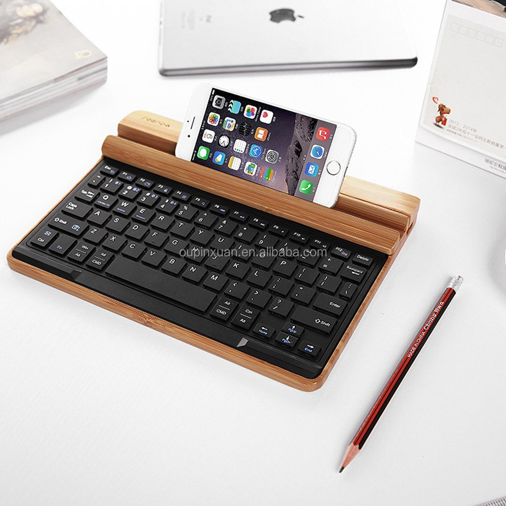 Universal Bluetooth 3 0 Wireless Keyboard Stand Phone Stand Bamboo Keyboard Device Holder Docking Station Stand For Compture Buy Keyboard Holder Phone Stand Desk Storage Product On Alibaba Com