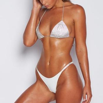 Models in sling bikinis