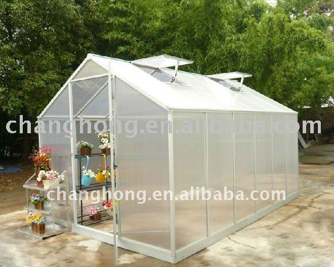 sturdy white greenhouse with four roof windows