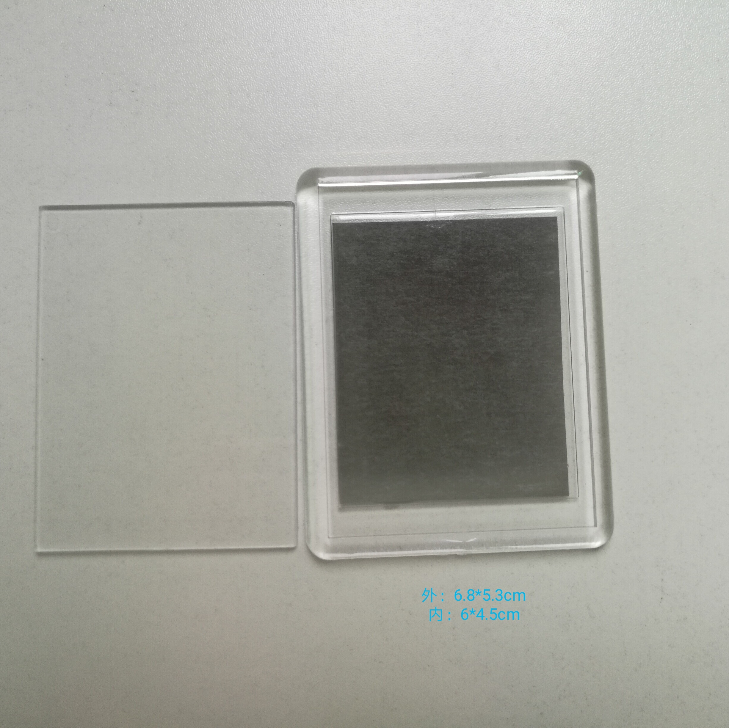 фото в пластике магнит судя