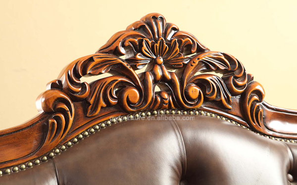 Carved wood and leather sofa sets a buy