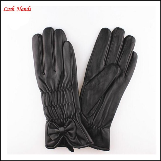 2015 lady's fashion black sheep leather gloves with bow