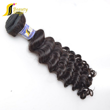 Tangle free natural color wholesale human virgin hair brazilian hair ocean wavy hair weft