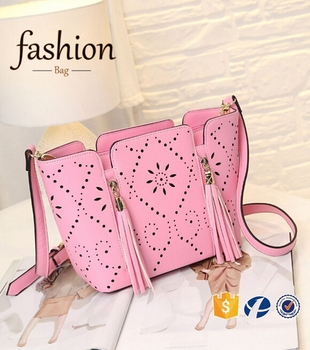 Cr High Retion Manufacture Handbags Latest Model Tassel Bag Long Strap Hollow Pattern Shoulder Handmade